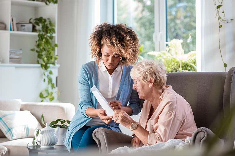 Home nurse taking care of a senior women