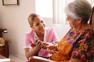 Health Aide Helps Elderly Woman