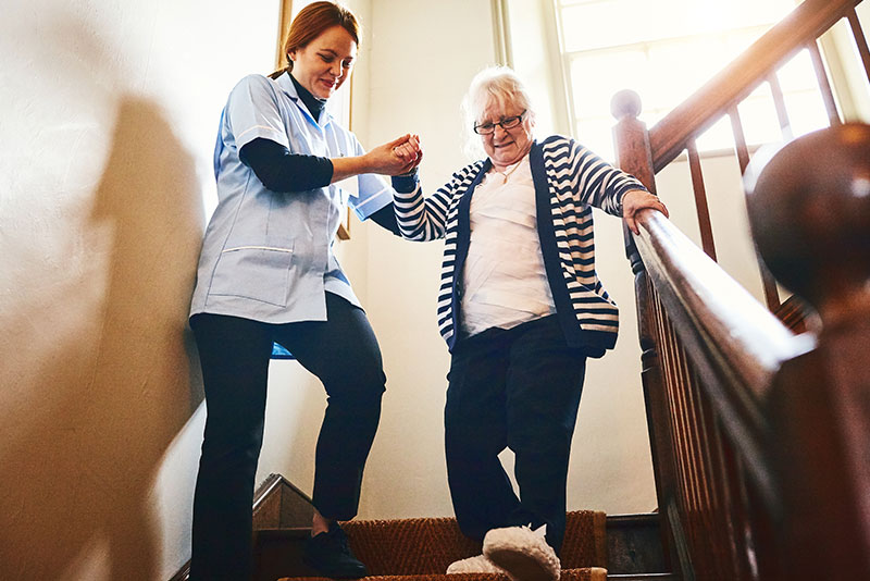 home health aide caring for a patient