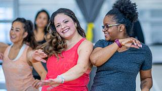 Friends dancing in a fitness studio